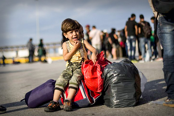 A Syrian refugee boy following his arrival in Greece (CREDIT: Freedom House via Flickr)